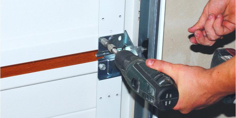 changing garage door opener - Ed Garage Door Repair Inc