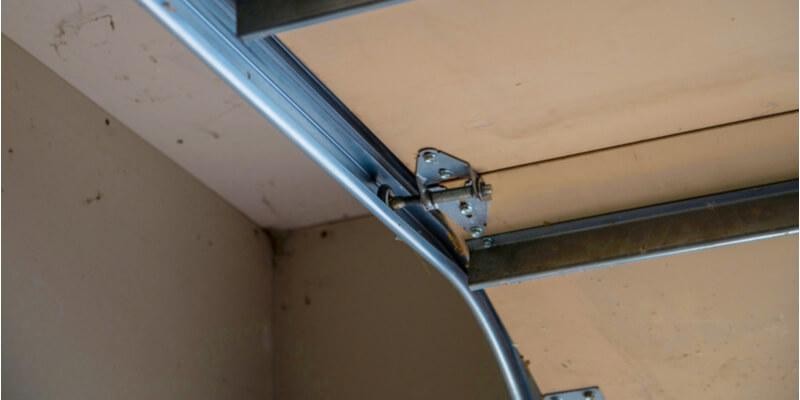 fix garage door spring - Ed Garage Door Repair Inc