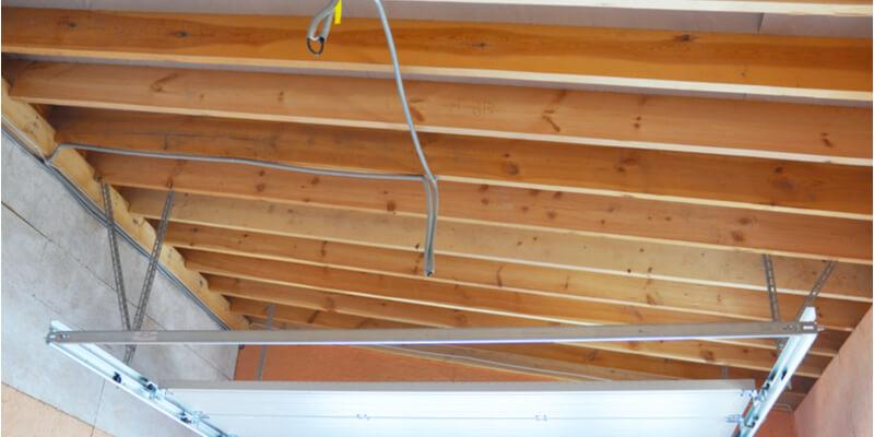 installing new garage door springs - Ed Garage Door Repair Inc