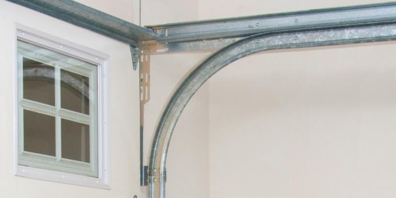 installing safety cables garage door spring - Ed Garage Door Repair Inc