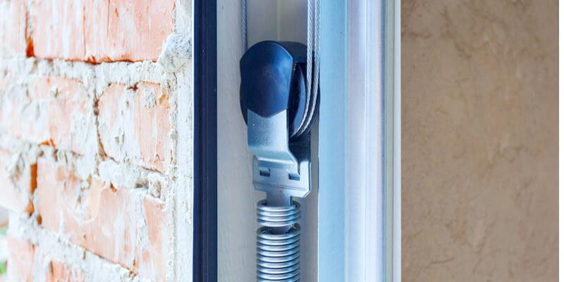 replace garage door extension spring - Ed Garage Door Repair Inc