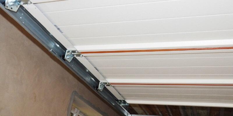 cable, roller, and hinge replacement - Ed Garage Door Repair Inc